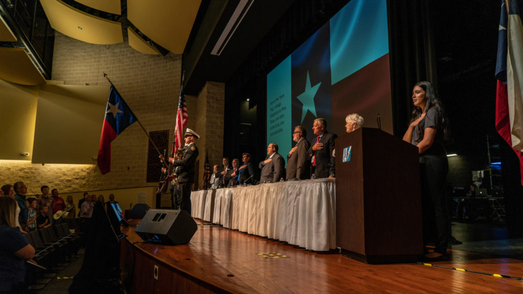 Marisa Ramirez (far right), one of PEC's 2018 Youth Tour delegates, leads the auditorium in both the national and state pledges.