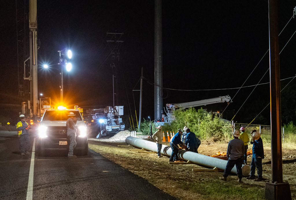 PEC crews worked through the night to minimize traffic interference while setting a new concrete pole for the project.
